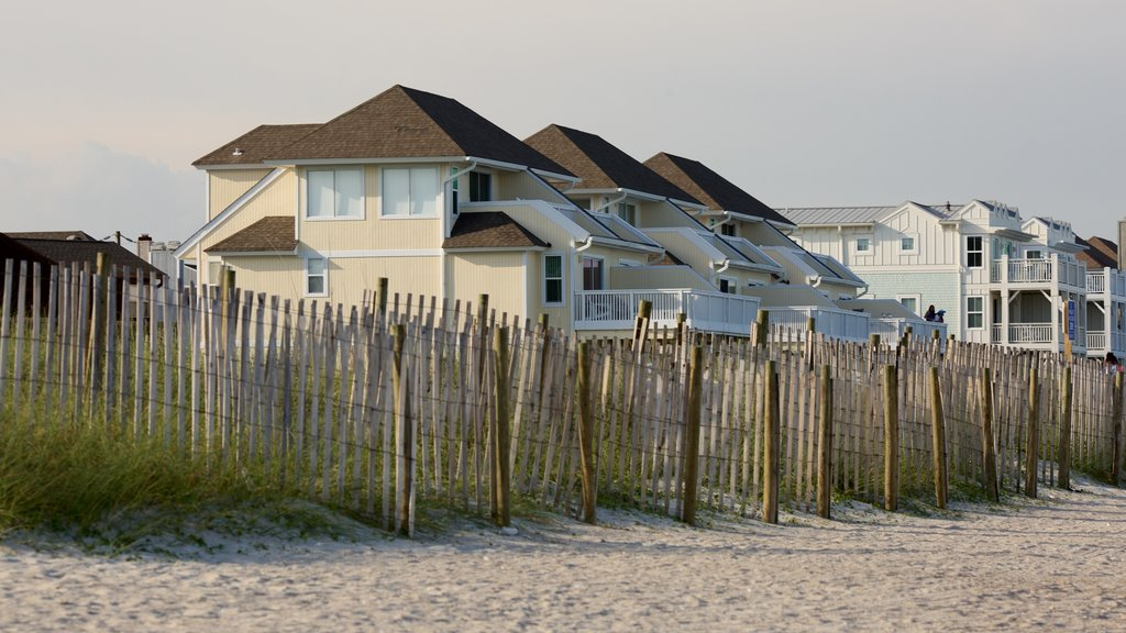Wrightsville Beach featuring general coastal views, a house and a sandy beach