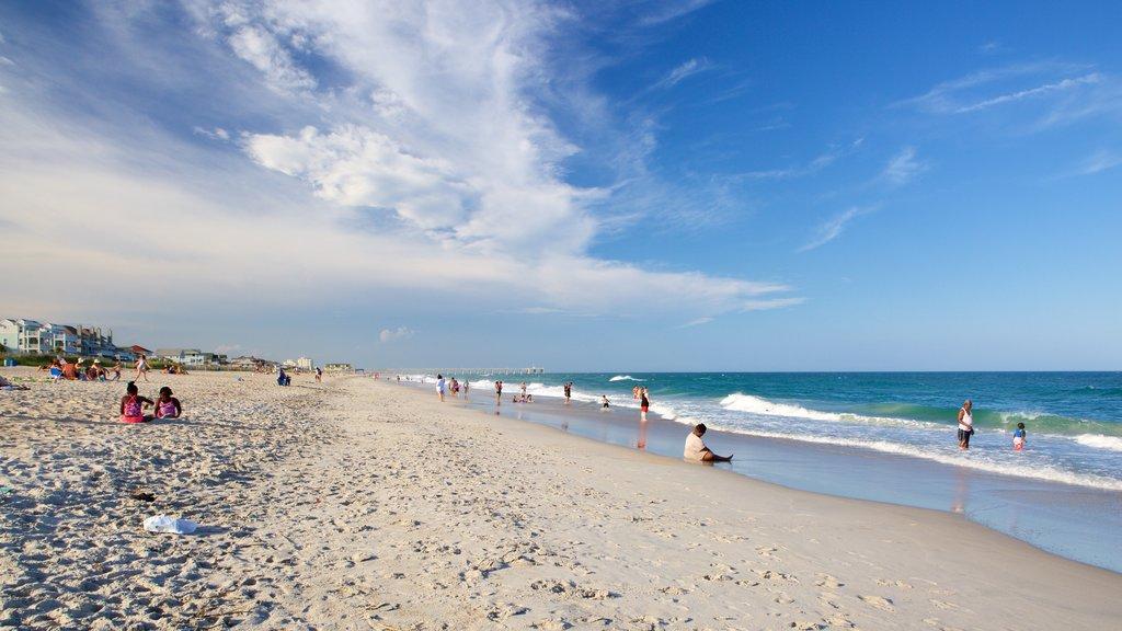Wrightsville Beach mostrando una playa y también un pequeño grupo de personas