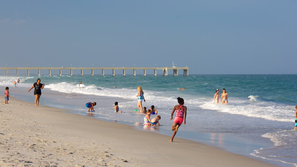 Wrightsville Beach featuring a sandy beach as well as a small group of people