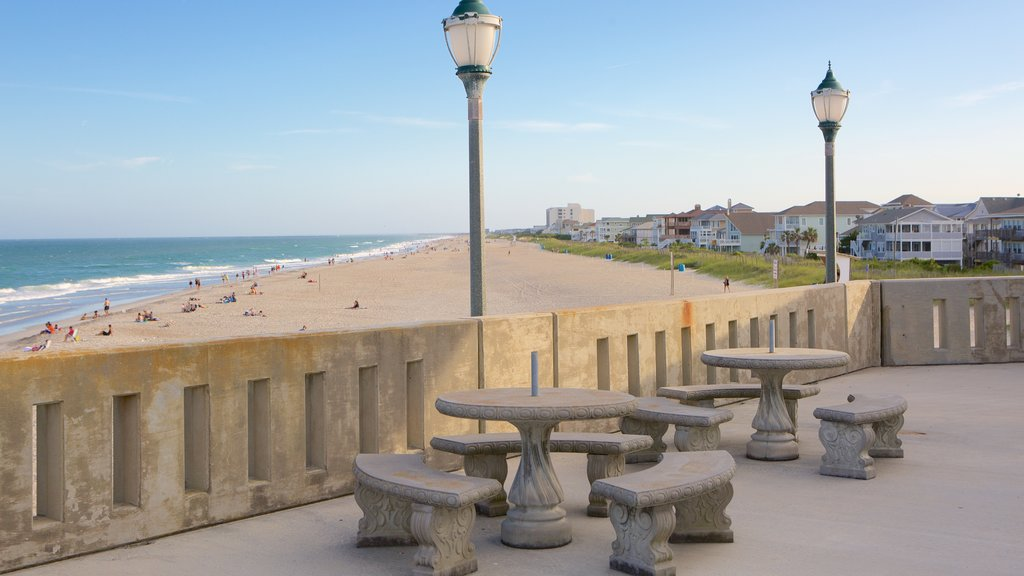 Wrightsville Beach which includes a coastal town, general coastal views and a sandy beach