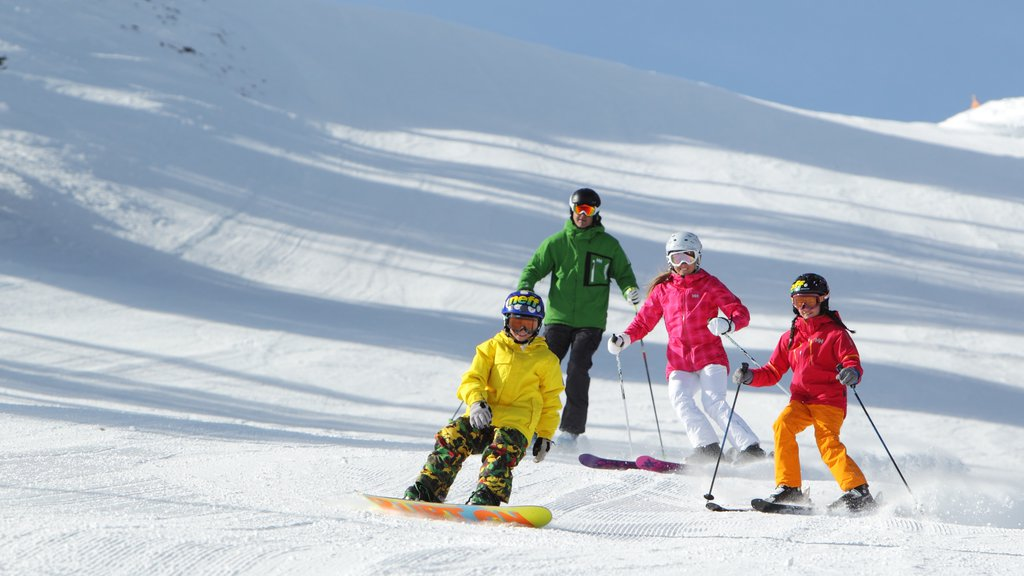 Park City Mountain Resort featuring snow skiing and snow as well as a family