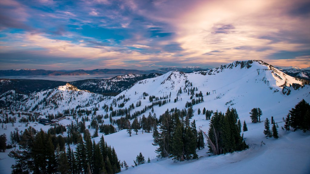 Squaw Valley Resort which includes a sunset, snow and landscape views