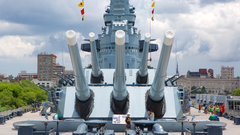 Battleship North Carolina showing heritage elements as well as a small group of people