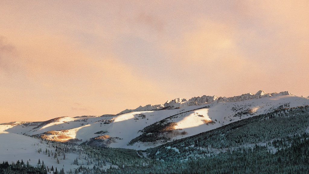 Vail Ski Resort which includes a sunset, landscape views and snow