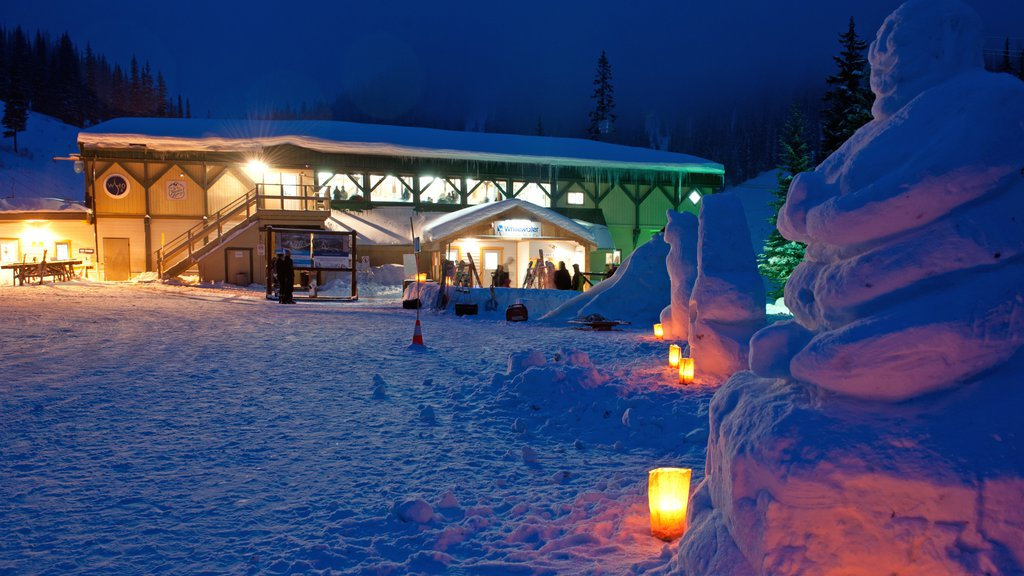 Whitewater Ski Resort featuring night scenes, a luxury hotel or resort and snow