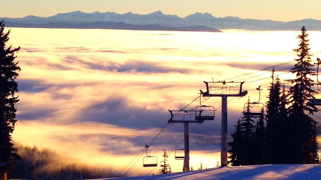 Silver Star Ski Resort which includes a sunset, landscape views and snow