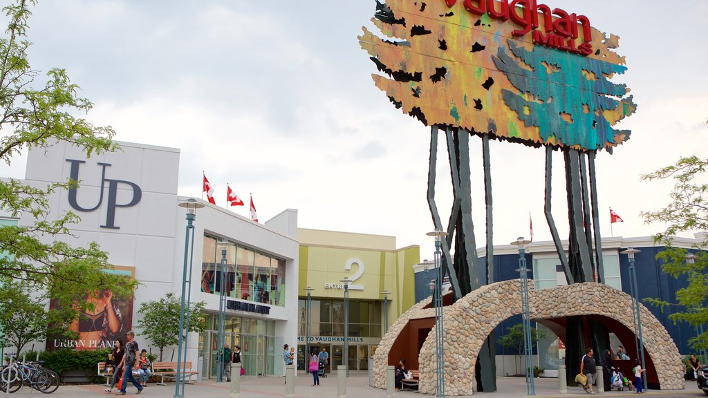 Vaughan Mills Mall which includes signage and a square or plaza as well as a small group of people
