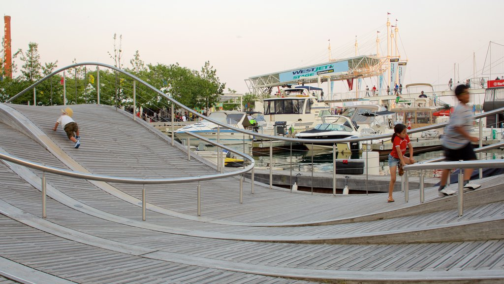Harbourfront featuring a marina as well as a small group of people