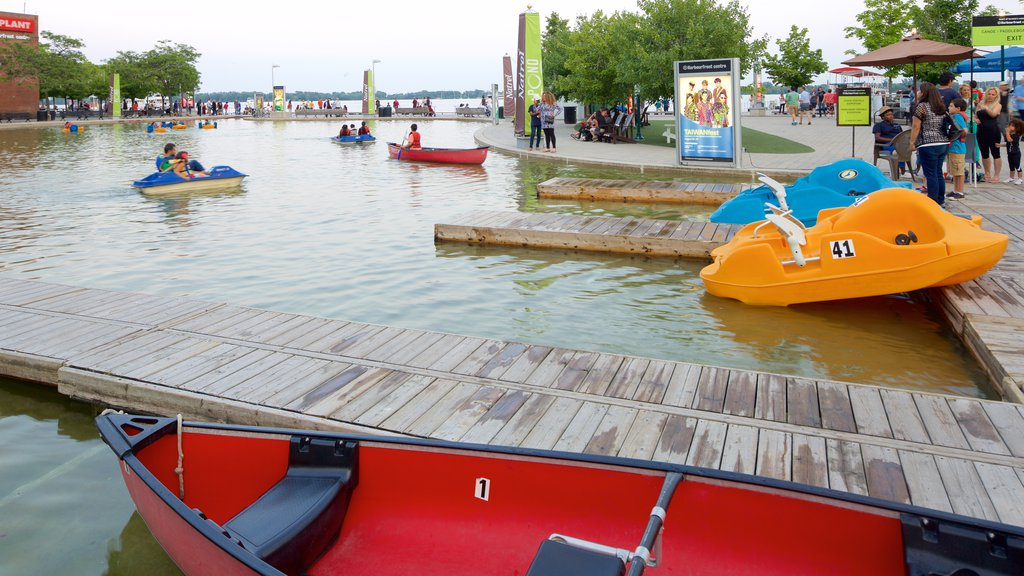 Harbourfront showing a lake or waterhole and watersports as well as a large group of people