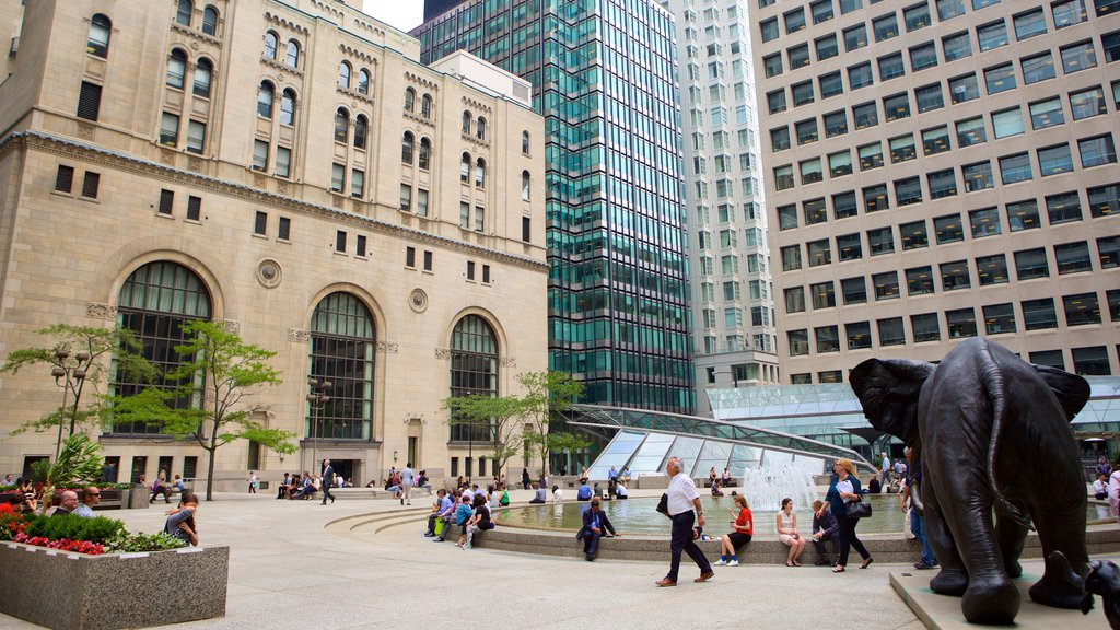 Financial District which includes a statue or sculpture, a city and modern architecture
