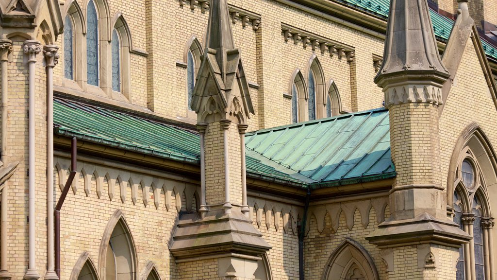 Downtown Toronto featuring a church or cathedral, religious elements and heritage elements
