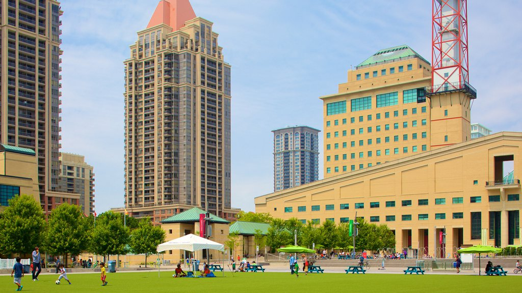 Mississauga Civic Centre featuring a city and a park as well as a small group of people