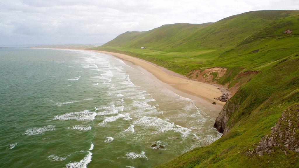 Rhossili Beach showing a beach and landscape views