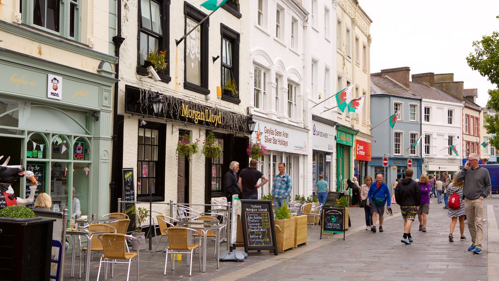 Caernarfon which includes street scenes as well as a large group of people