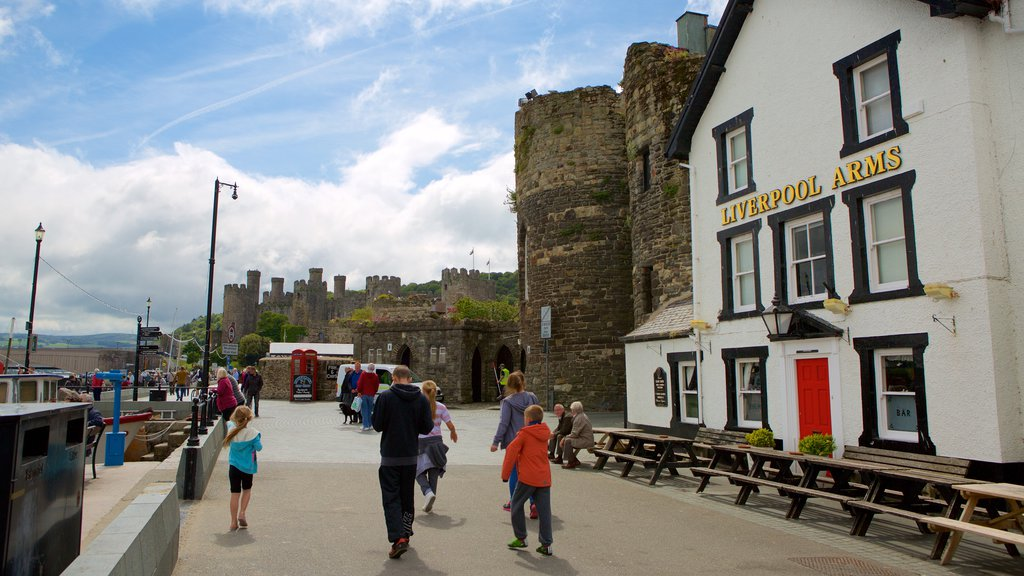 Conwy featuring street scenes as well as a small group of people