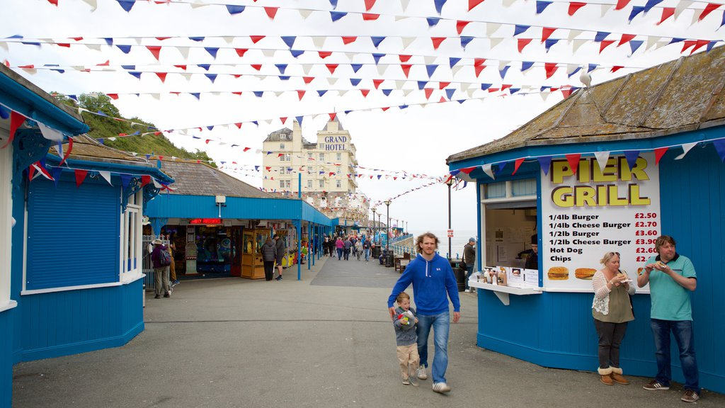 Llandudno Pier featuring street scenes as well as a small group of people