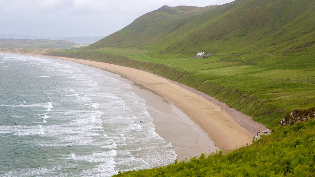 Rhossili Beach showing a sandy beach, landscape views and a bay or harbor