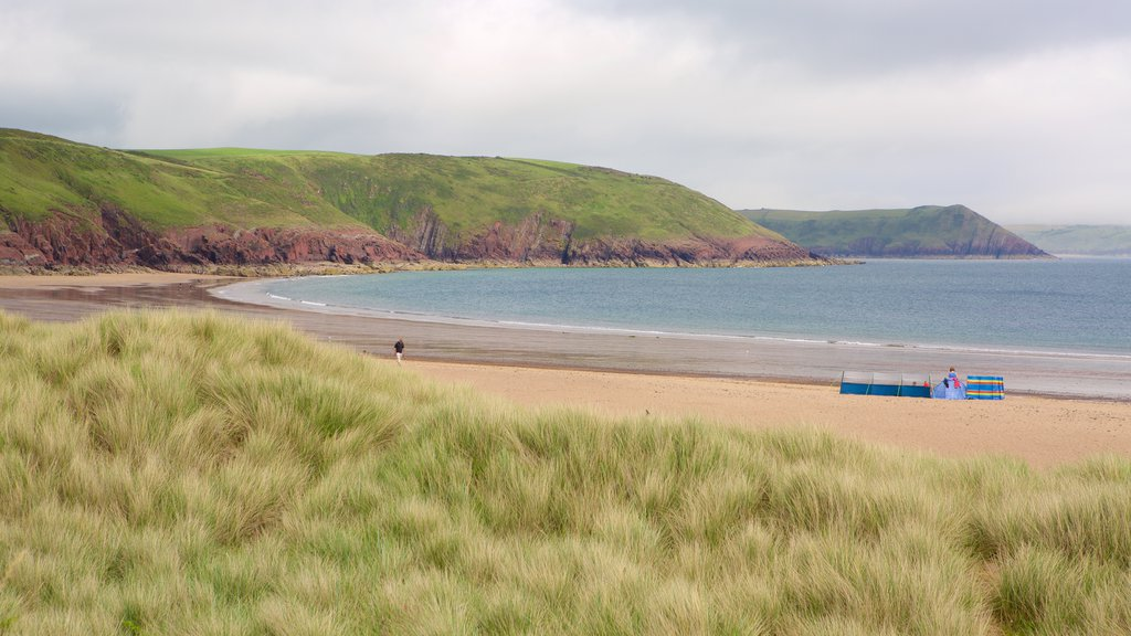 Freshwater East Beach featuring a beach, a bay or harbor and general coastal views