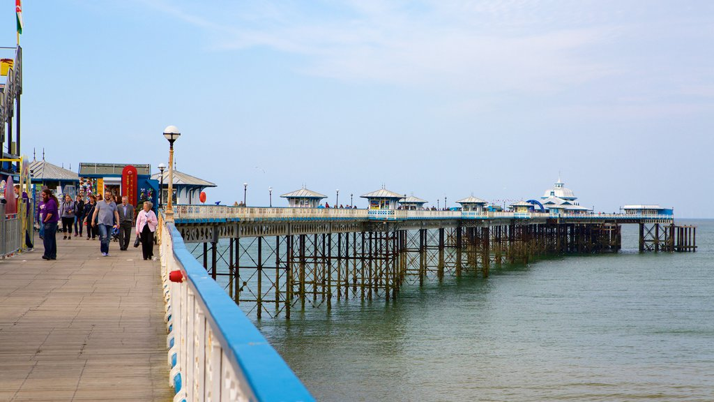 Llandudno Pier featuring general coastal views as well as a small group of people
