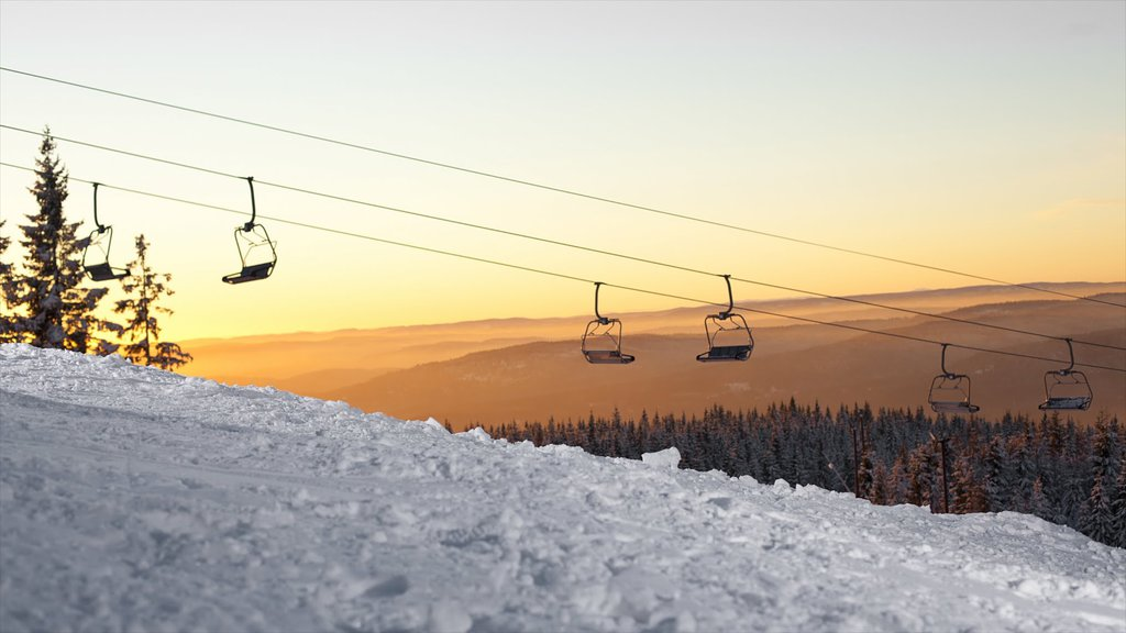 Oslo Winter Park featuring a gondola, snow and a sunset