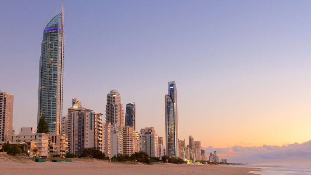 Surfers Paradise which includes a city, a beach and a sunset