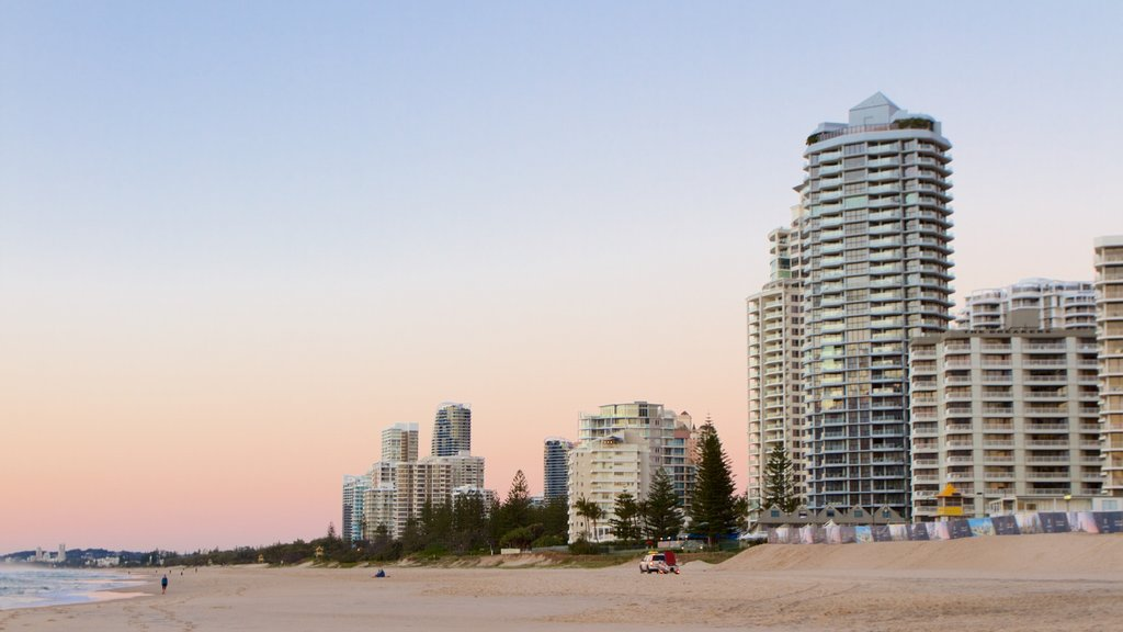 Surfers Paradise which includes a sunset, a sandy beach and a city