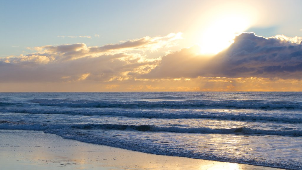 Surfers Paradise featuring a beach and a sunset