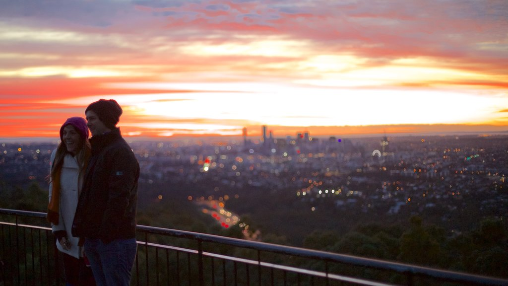 Mt. Coot-Tha featuring views and a sunset as well as a couple