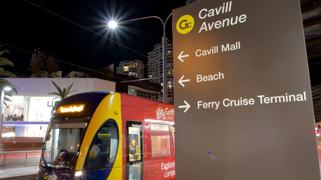 Cavill Avenue featuring railway items, night scenes and signage