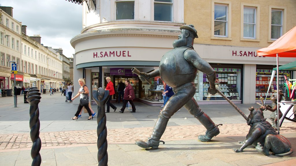 Desperate Dan Statue which includes outdoor art and street scenes