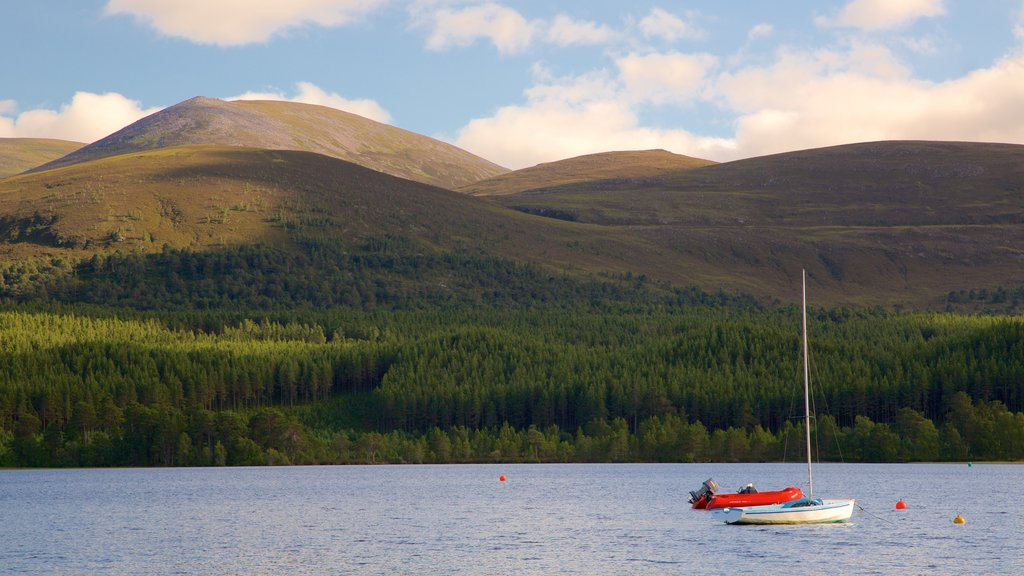 Loch Morlich showing sailing, mountains and forests