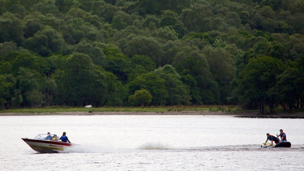 Loch Earn featuring a lake or waterhole, forest scenes and boating