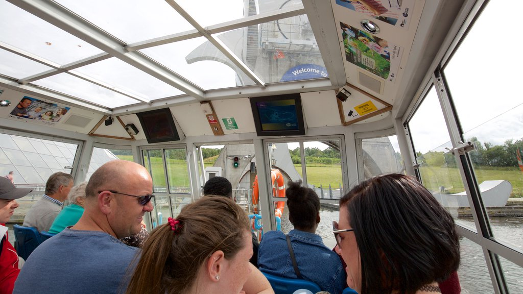 Falkirk Wheel featuring boating and interior views as well as a large group of people