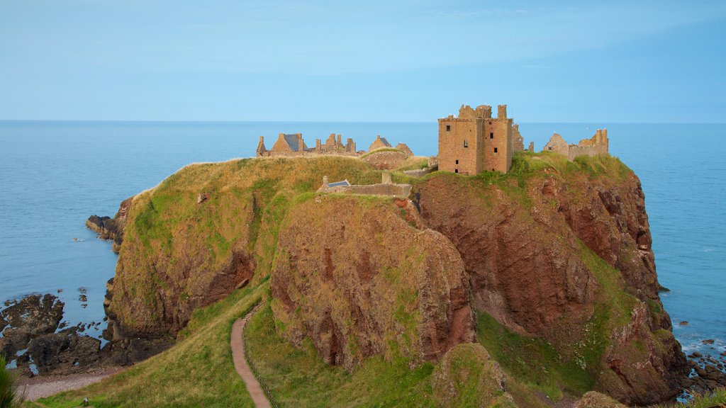 Dunnottar Castle showing general coastal views, farmland and heritage elements