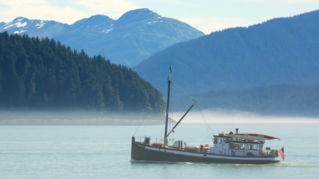 Alaska which includes mist or fog, boating and general coastal views