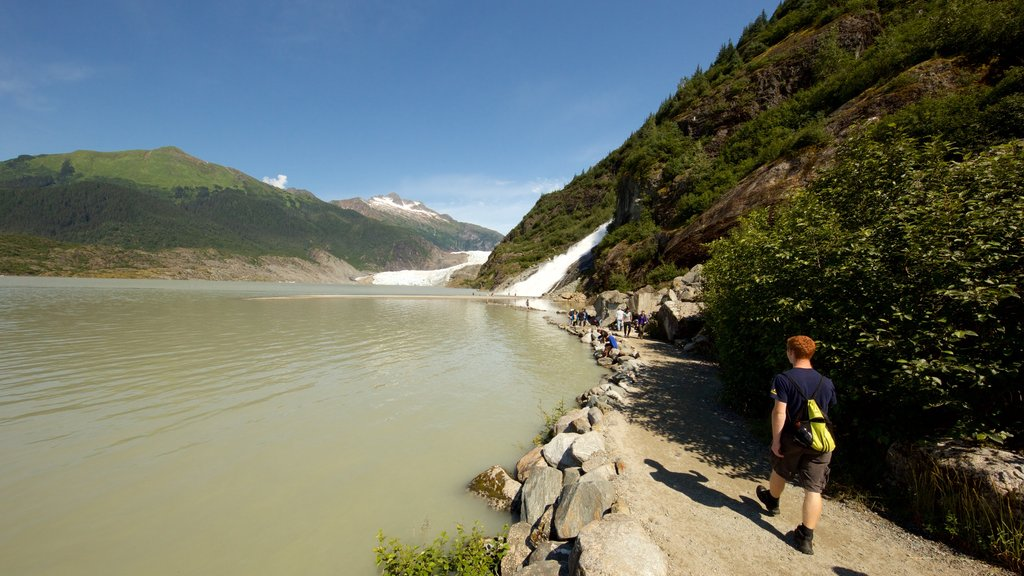 Mendenhall Glacier which includes a river or creek as well as an individual child
