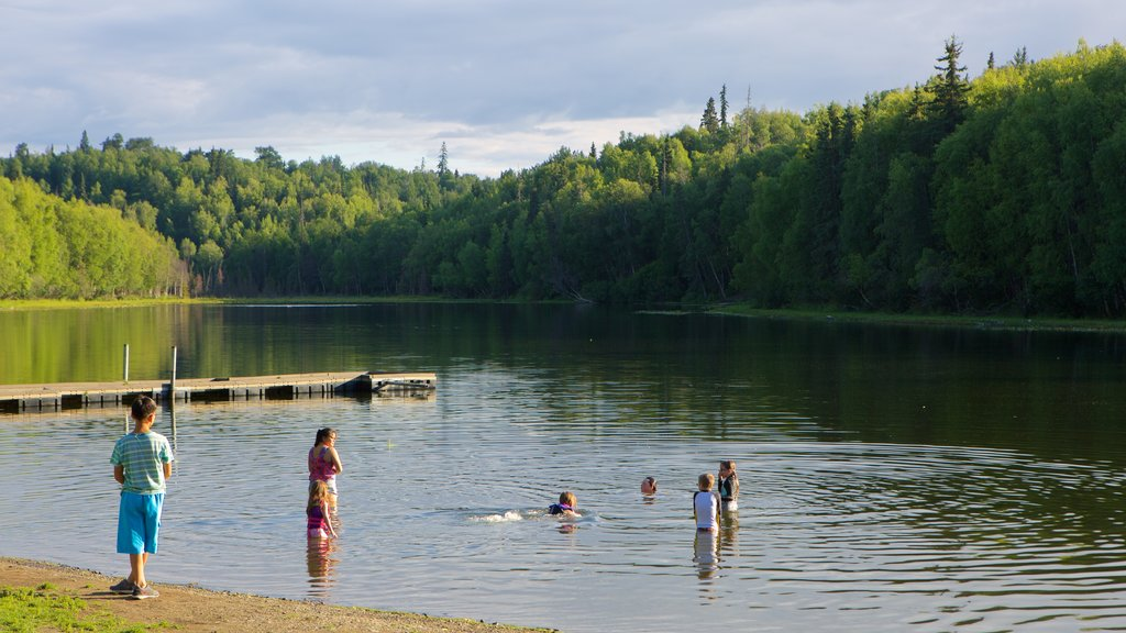 Anchorage which includes a lake or waterhole and swimming as well as children