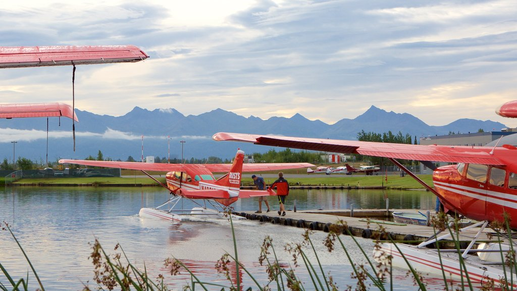 Anchorage showing a lake or waterhole, an aircraft and aircraft
