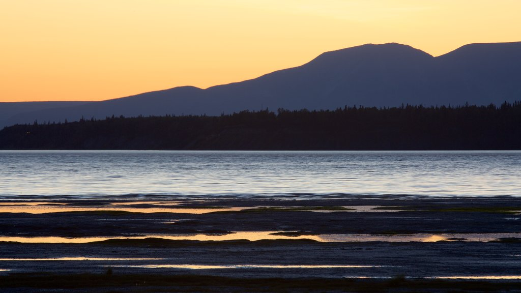 Anchorage which includes mountains, general coastal views and a sunset