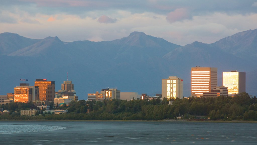 Anchorage which includes a sunset, general coastal views and modern architecture