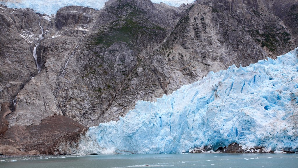 Kenai Fjords National Park featuring mountains, snow and rugged coastline