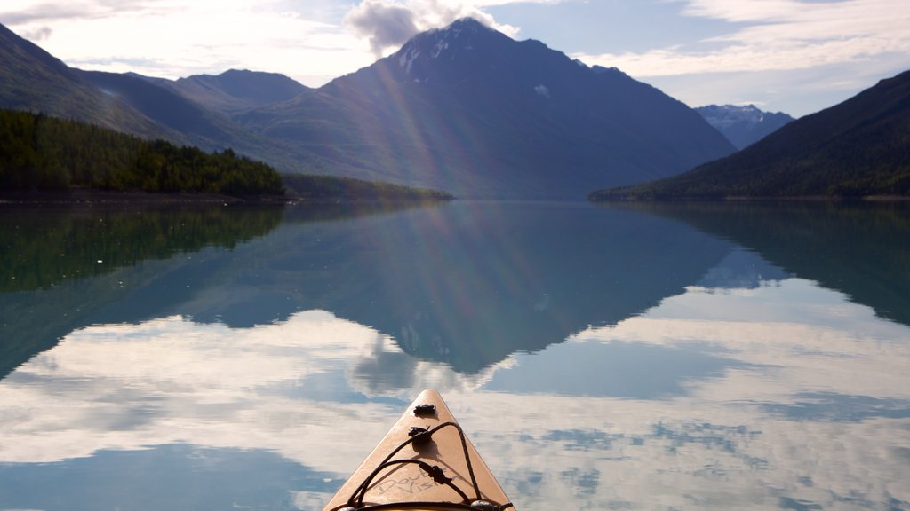 Eklutna Lake which includes mountains, a lake or waterhole and kayaking or canoeing