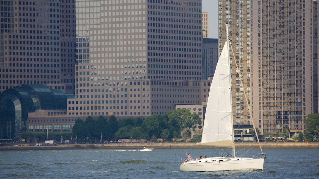 Liberty State Park showing a city, sailing and a river or creek