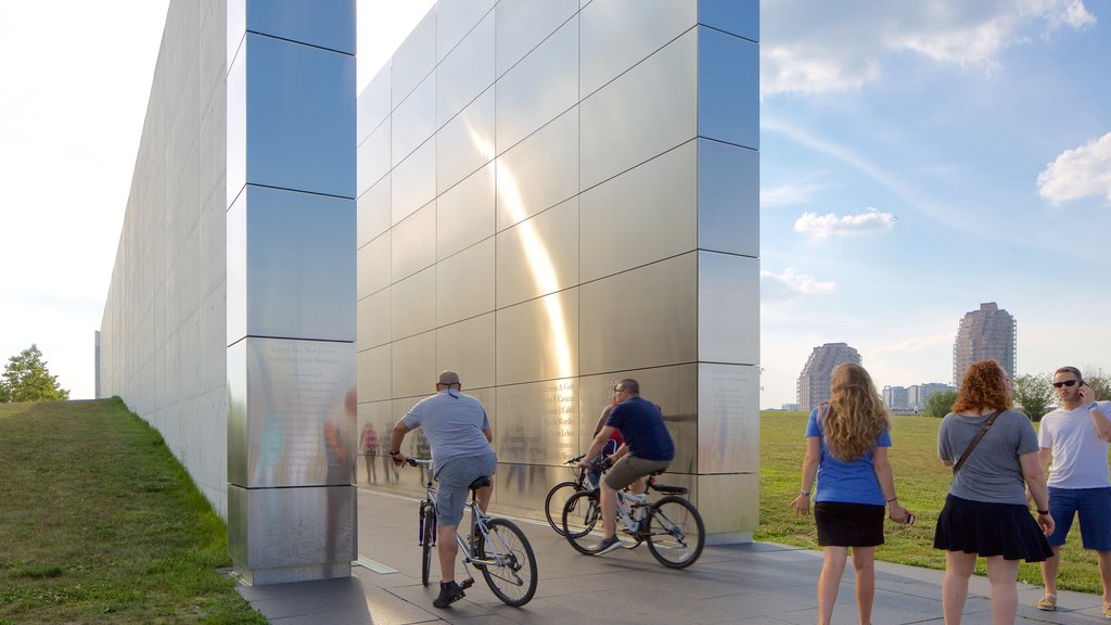 Empty Sky Memorial which includes cycling and a monument as well as a large group of people