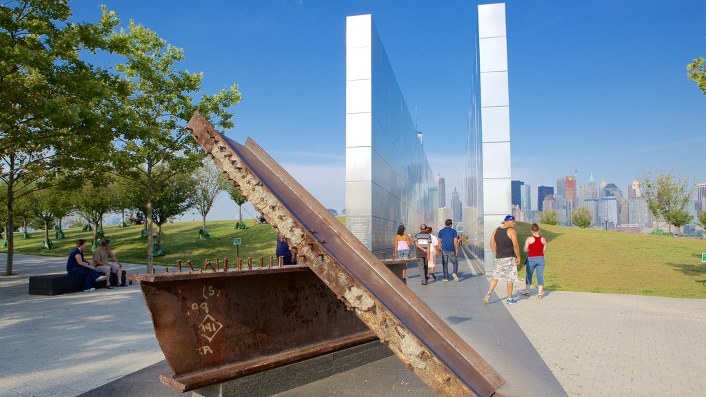 Empty Sky Memorial showing a monument as well as a large group of people