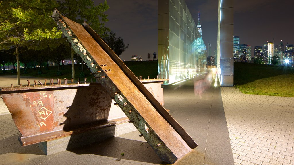 Empty Sky Memorial featuring night scenes and a monument