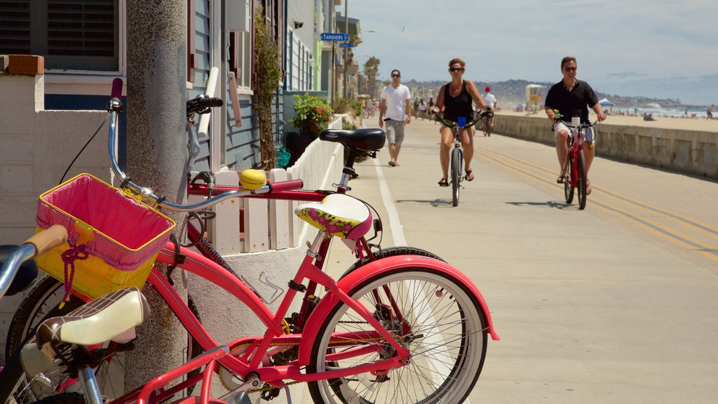 Pacific Beach Park showing cycling, street scenes and a coastal town