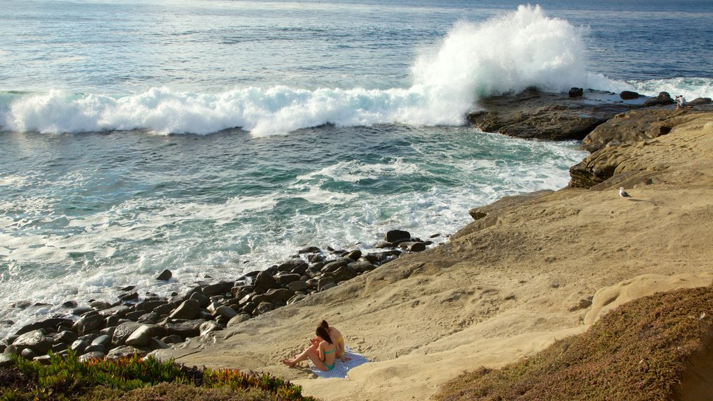 La Jolla featuring surf, rocky coastline and general coastal views