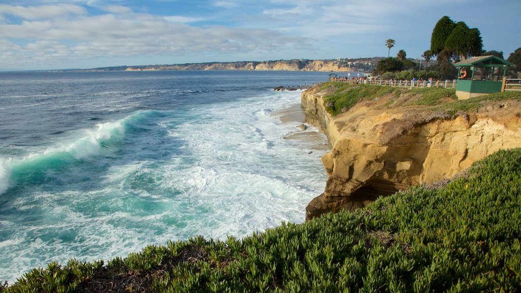La Jolla which includes surf, general coastal views and rocky coastline