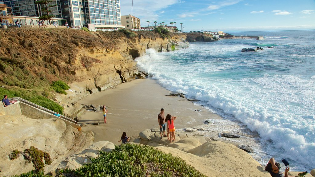 La Jolla which includes rugged coastline, surf and a coastal town